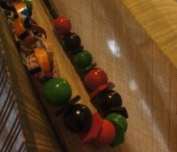 Necklace made from wooden beads and aluminum cans by Avatar